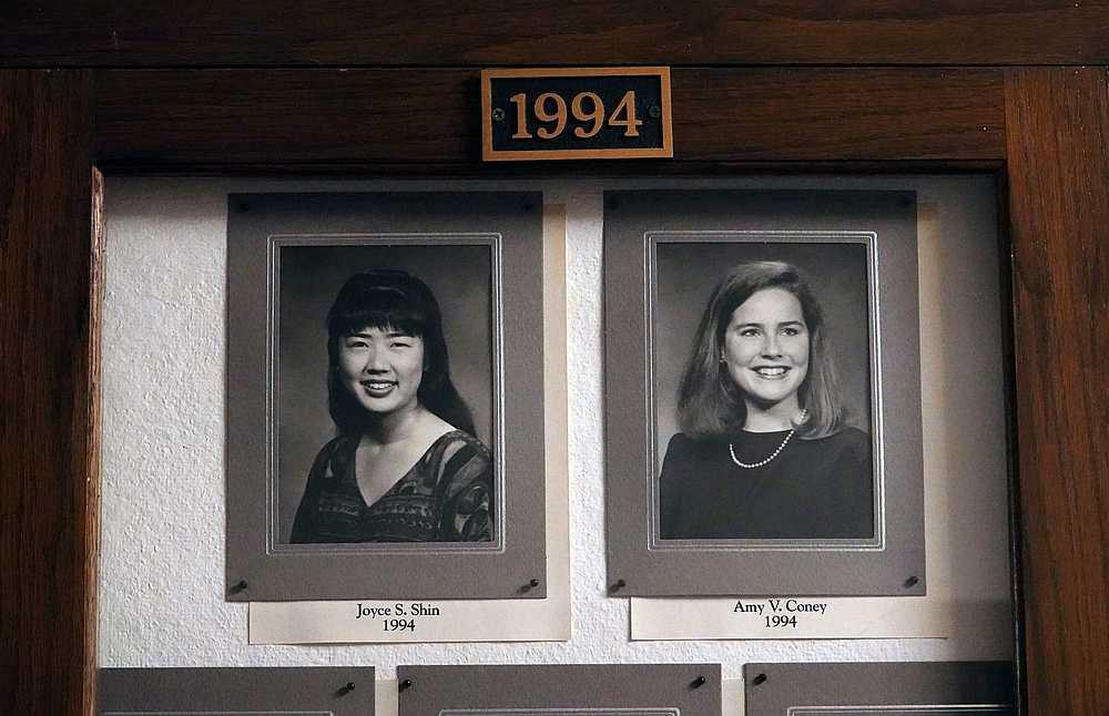 A picture of Amy Coney Barrett (right), a potential Supreme Court nominee, hang in the Hall of Fame of Rhodes College in Memphis, Tennessee September 22, 2020. — Reuters pic