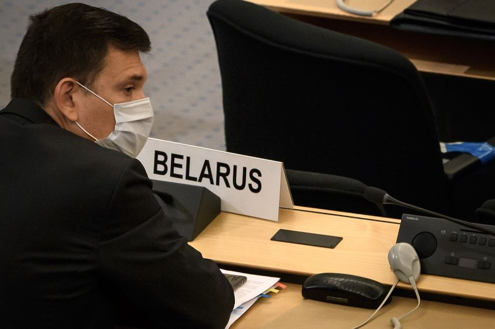 Belarus' ambassador Yury Ambrazevich wearing a protective face mask attends a meeting of the United Nations Human Rights Council on allegations of torture and other serious violations in his country, September 18, 2020 in Geneva. — AFP pic