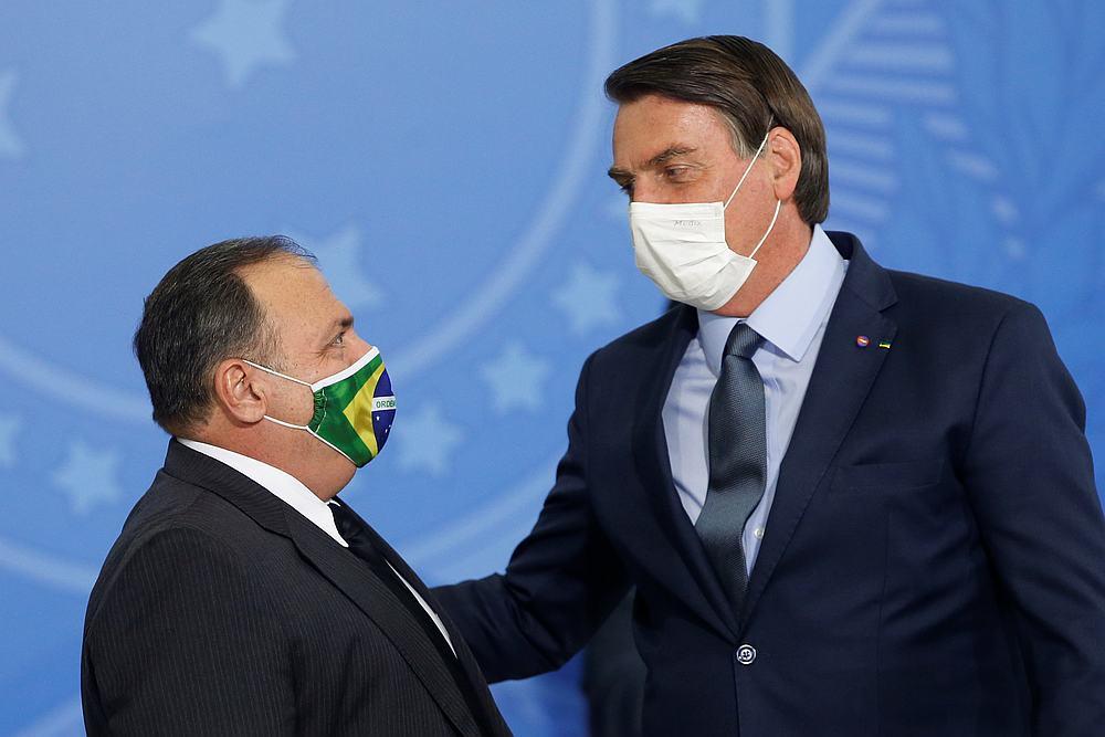 Brazil's President Jair Bolsonaro (right) greets the new Health Minister Eduardo Pazuello during an inauguration ceremony at the Planalto Palace in Brasilia, Brazil September 16, 2020. — Reuters pic