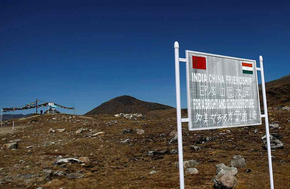 File photo of a signboard seen from the Indian side of the Indo-China border at Bumla, in the northeastern Indian state of Arunachal Pradesh November 11, 2009. — Reuters pic