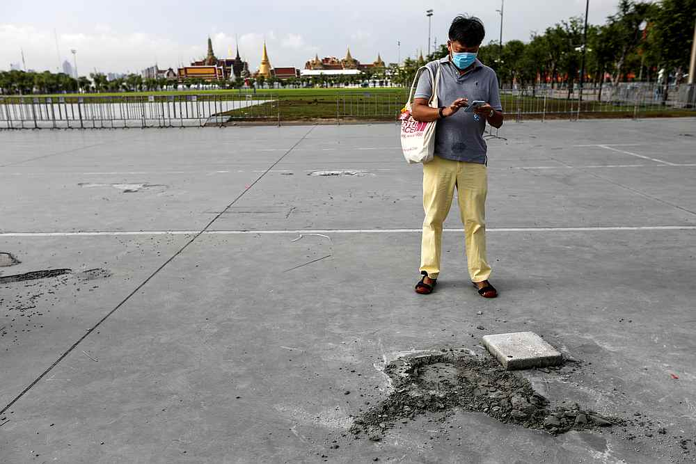 A man stands near the place where a plaque placed by Thai pro-democracy protesters near the Grand Palace has been removed according to police, in Bangkok, Thailand September 21, 2020. — Reuters pic