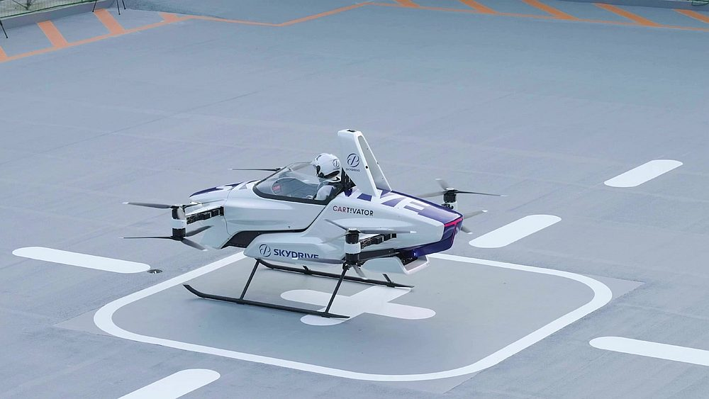 SkyDrive hails 'the first public demonstration of a flying car in Japan' and says the vehicle, around the size of two parked cars, circled the testing field for four minutes. — AFP pic