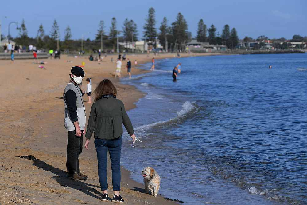 People enjoy the sunshine, as Victoria state begins easing Covid-19 restrictions, at Elwood beach in Melbourne, Australia September 14, 2020. — AAP Image via Reuters