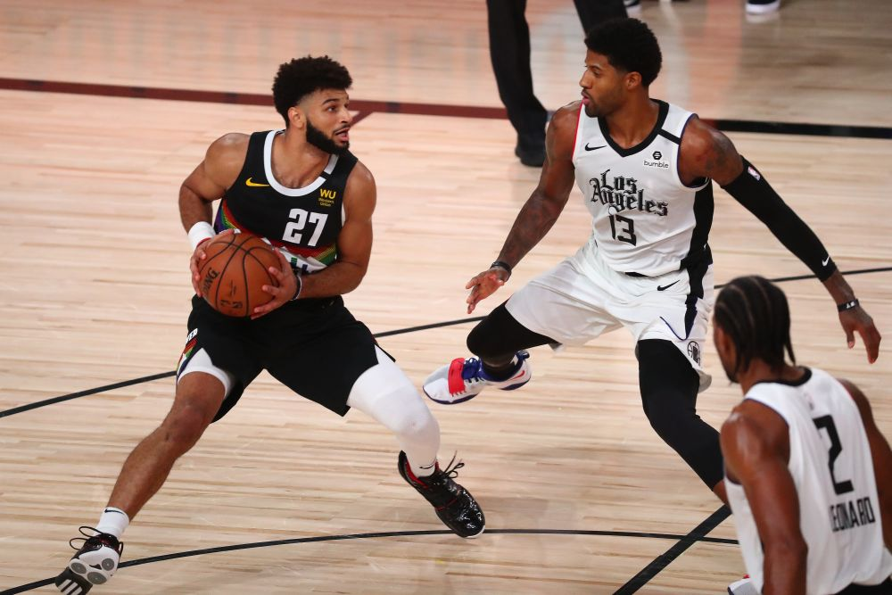 Denver Nuggets guard Jamal Murray (27) drives against LA Clippers guard Paul George (13) during game three of the second round of the 2020 NBA Playoffs at AdventHealth Arena September 7, 2020. — Reuters pic