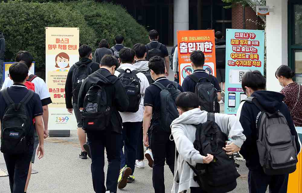 High school students arrive at a school, amid the Covid-19 pandemic, in Seoul, South Korea September 21, 2020. — Yonhap pic via Reuters