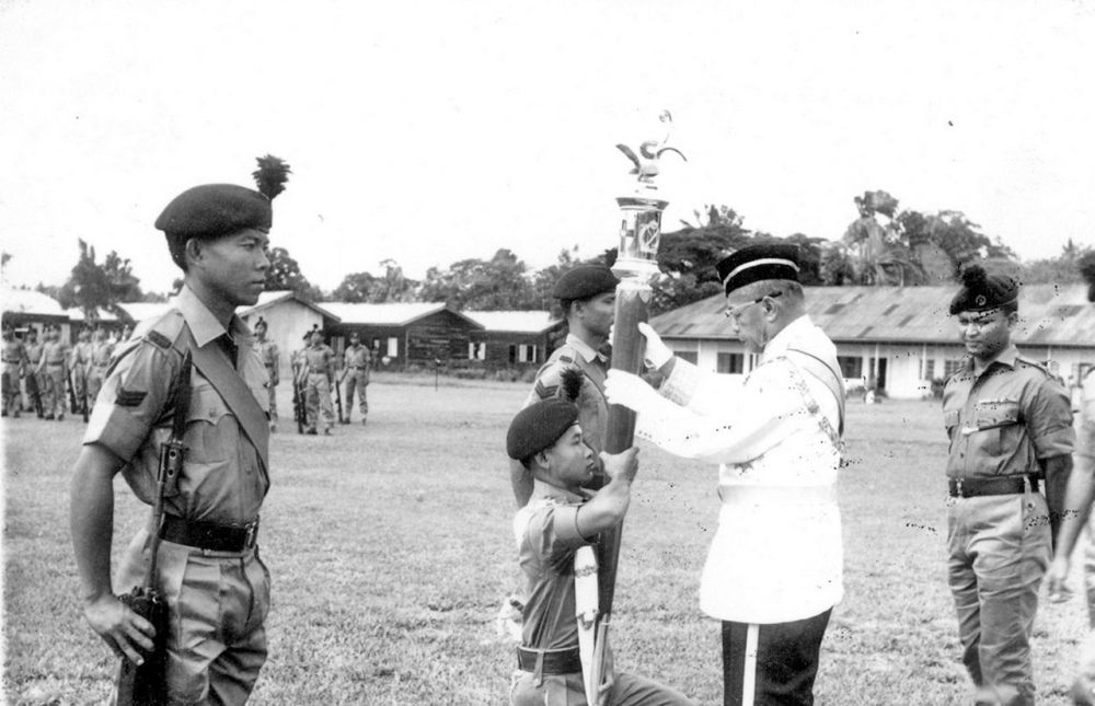 Angking receiving the Battle Truncheon presented by the Head of State, the late Tun Abang Haji Openg Abang Sapi'ee November 19, 1966 in Lundu. — Borneo Post pic