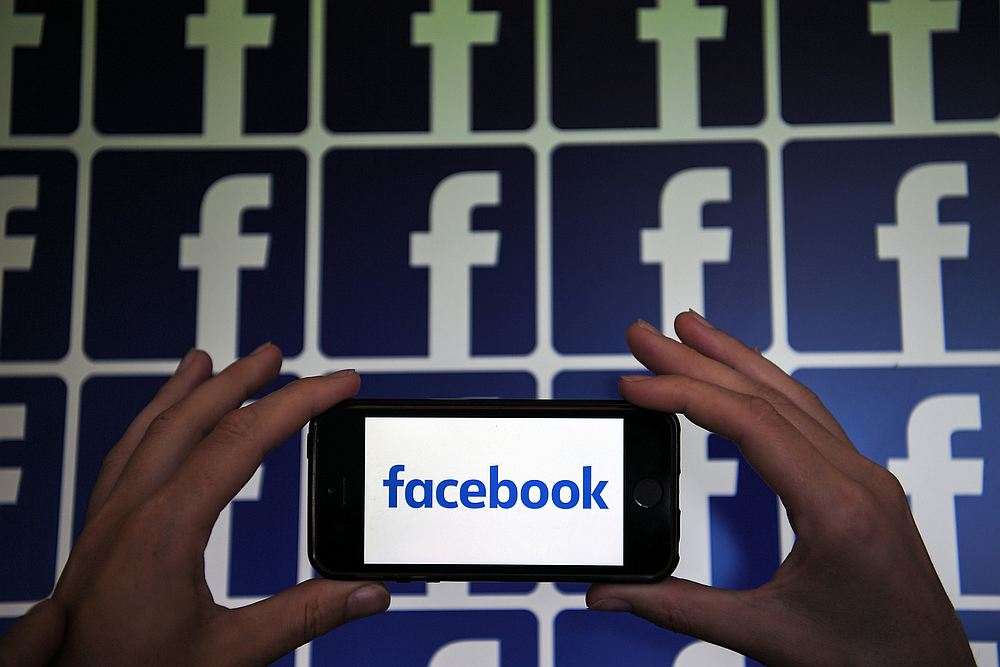 Facebook's Watch Together is designed to let people enjoy videos simultaneously while chatting with friends on screen in a video call. — AFP pic