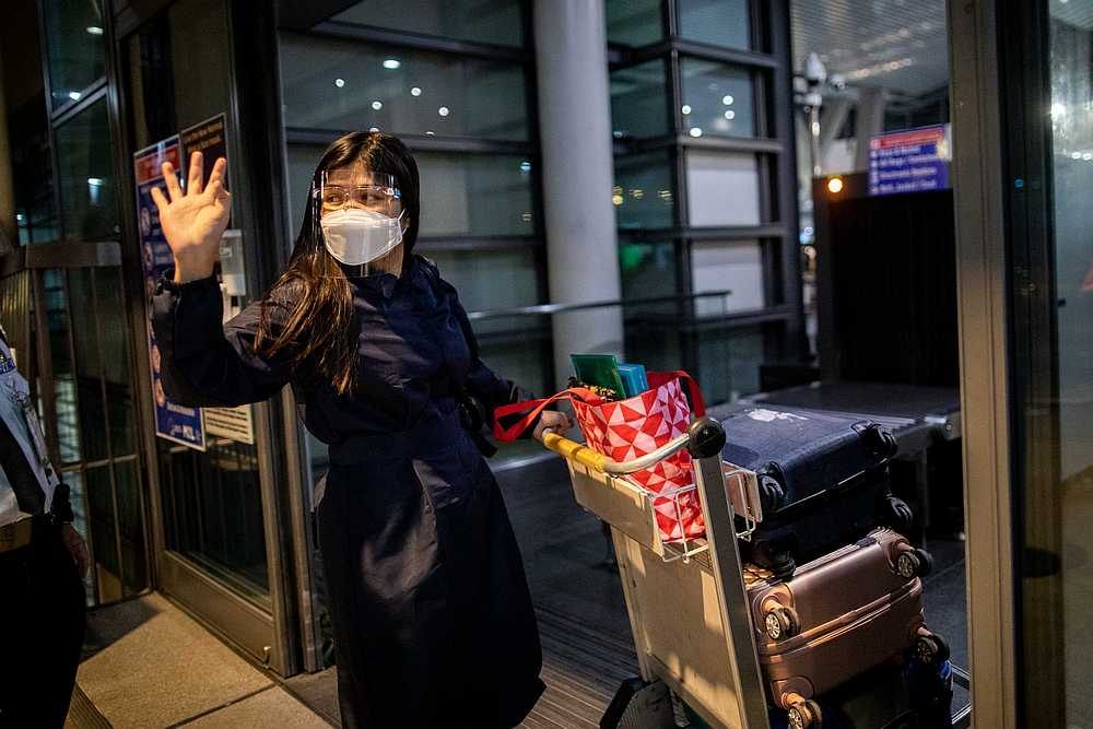 Filipino nurse April Glory waves to her family before leaving for the UK, outside Ninoy Aquino International Airport in Manila, Philippines after the government partially eased curbs August 20, 2020. — Reuters pic