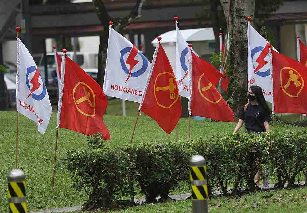 People's Action Party and Workers' Party flags in Hougang during the General Election 2020 hustings. — TODAY pic