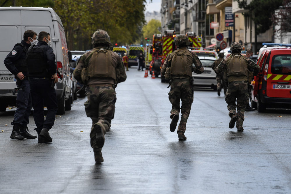 French soliders rush to the scene after several people were injured near the former offices of the French satirical magazine Charlie Hebdo following an alleged attack by a man wielding a knife in the capital Paris September 25, 2020. — AFP pic