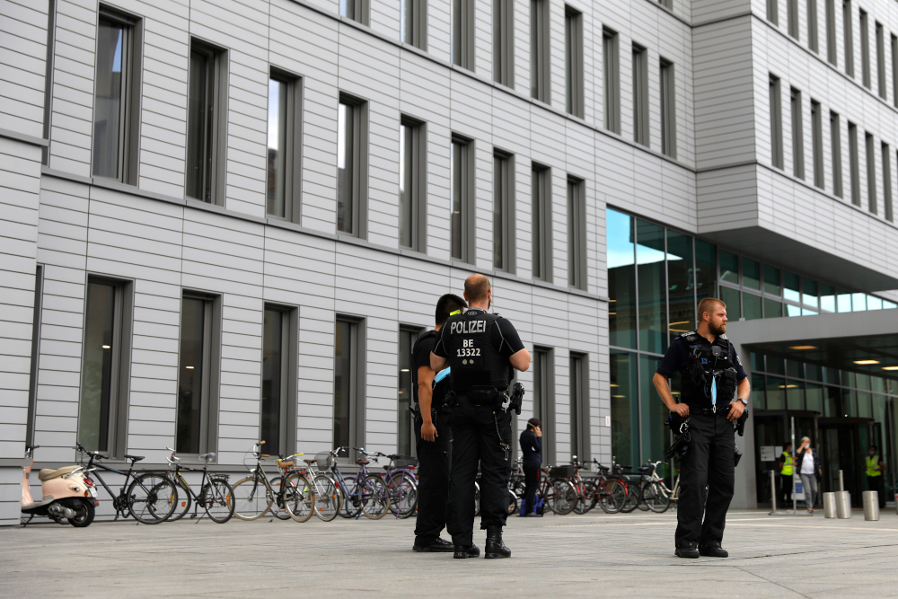 German police officers stand guard outside Berlin's Charite hospital August 24, 2020, where Alexei Navalny is treated after his medical evacuation to Germany following a poisoning. — AFP pic