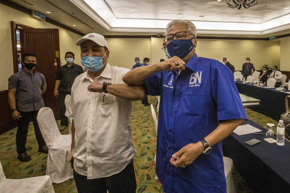 Datuk Hajiji Noor (left) with Datuk Seri Ismail Sabri Yaakob at the Magellan Sutera Resort in Kota Kinabalu September 27, 2020. — Picture by Firdaus Latif