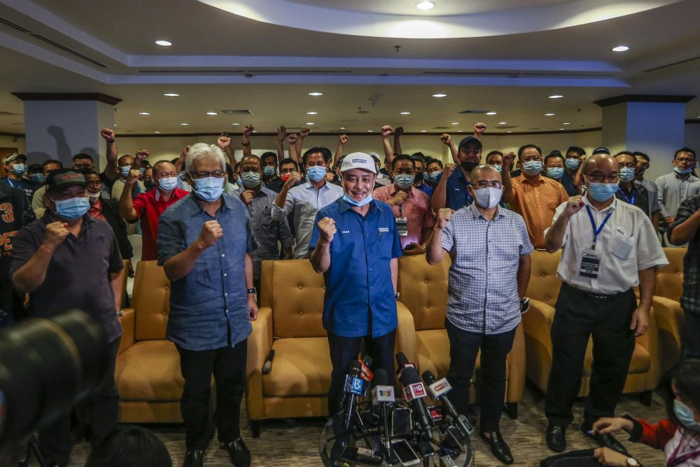 Sabah Bersatu chief Datuk Hajiji Noor (centre) poses for a group photo with Gabungan Rakyat Sabah leaders during a press conference at the Magellan Sutera Resort in Kota Kinabalu September 26, 2020. — Picture by Firdaus Latif