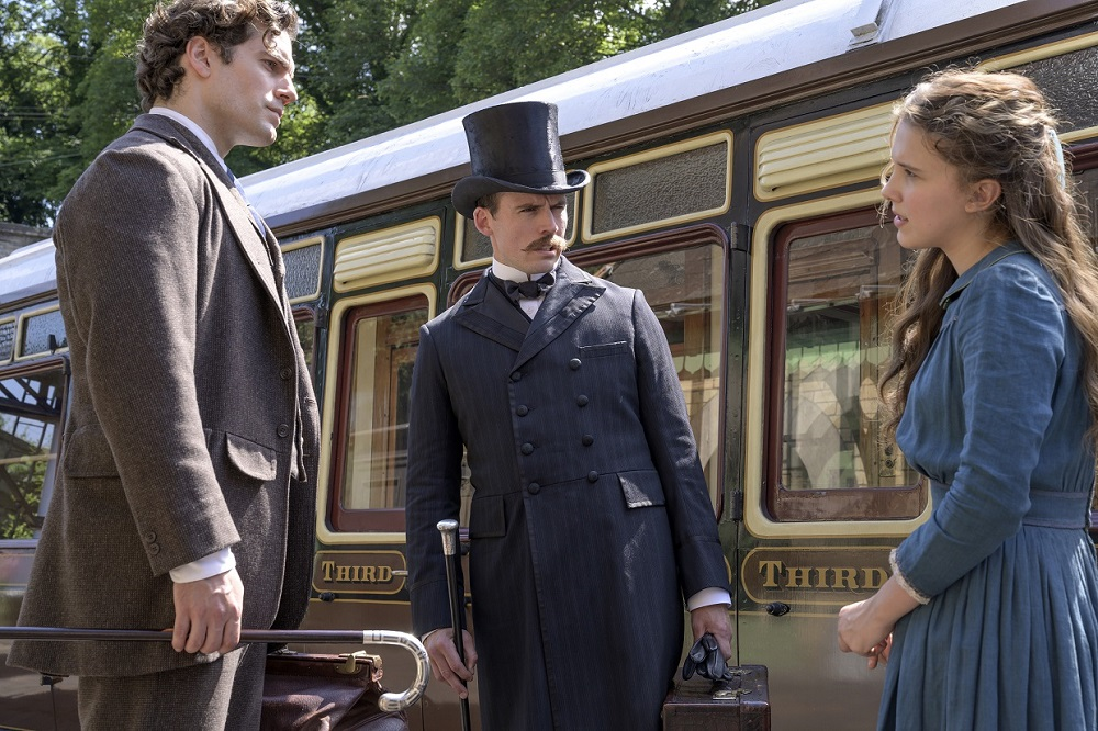 Cavill (left) with actors Sam Claflin and Millie Bobby Brown in a scene from 'Enola Holmes'. ― Picture courtesy of Netflix
