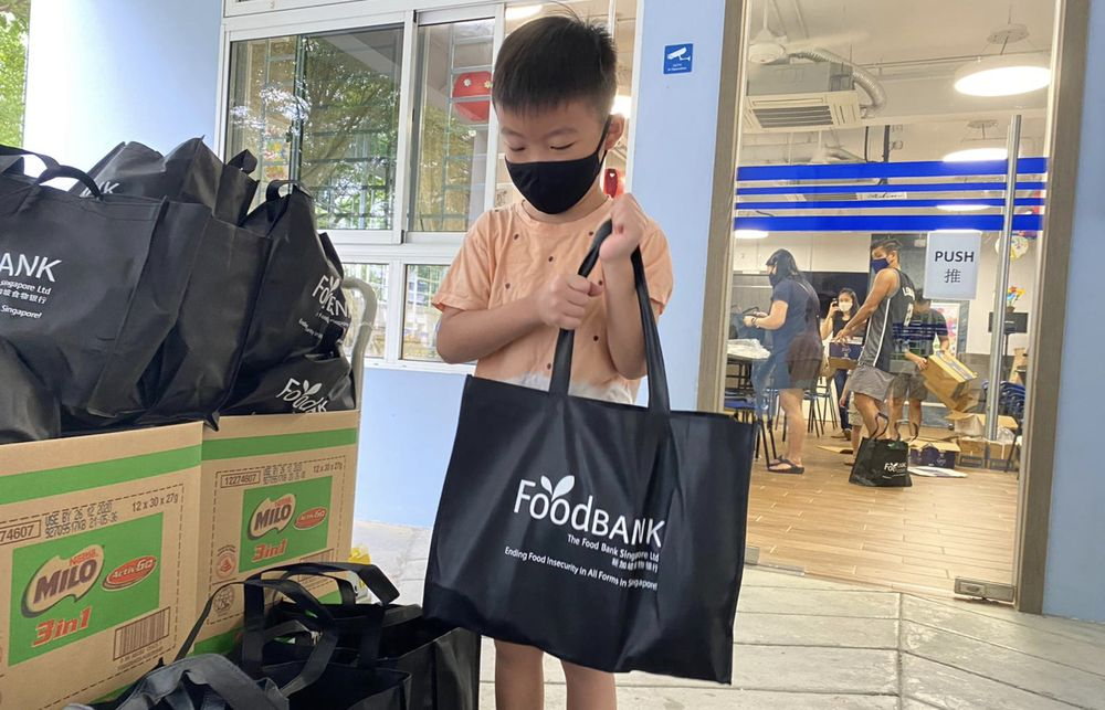 A boy helping to sort donated items at The Food Bank Singapore. — The Food Bank Singapore/Facebook/TODAY pic