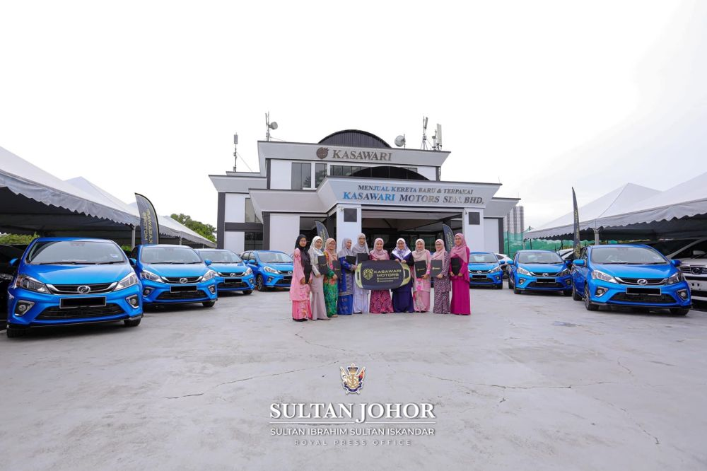 The 10 nurses from the Sultanah Aminah Hospital's Royal Ward and their new Myvis at the Kasawari Motors Sdn Bhd office in Larkin, Johor Baru.  — Picture courtesy of Johor Royal Press Office
