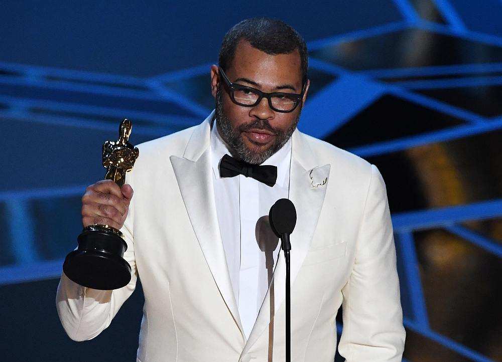 Director Jordan Peele delivers a speech after he won the Oscar for Best Original Screenplay during the 90th Annual Academy Awards show in Hollywood, California. — AFP pic