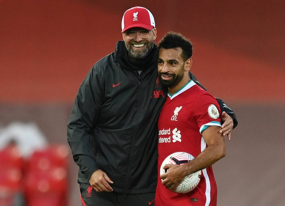Liverpool's Mohamed Salah celebrates scoring a hattrick with the match ball and manager Juergen Klopp after the EPL match with Leeds United at Anfield, Liverpool September 12, 2020. — Pool pic via via Reuters