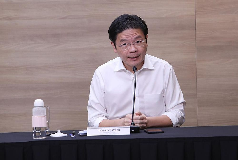Lawrence Wong says the progressive trajectory towards the third phase of reopening Singapore's economy is contingent on the people doing their part. — Ministry of Communications and Information pic via TODAY