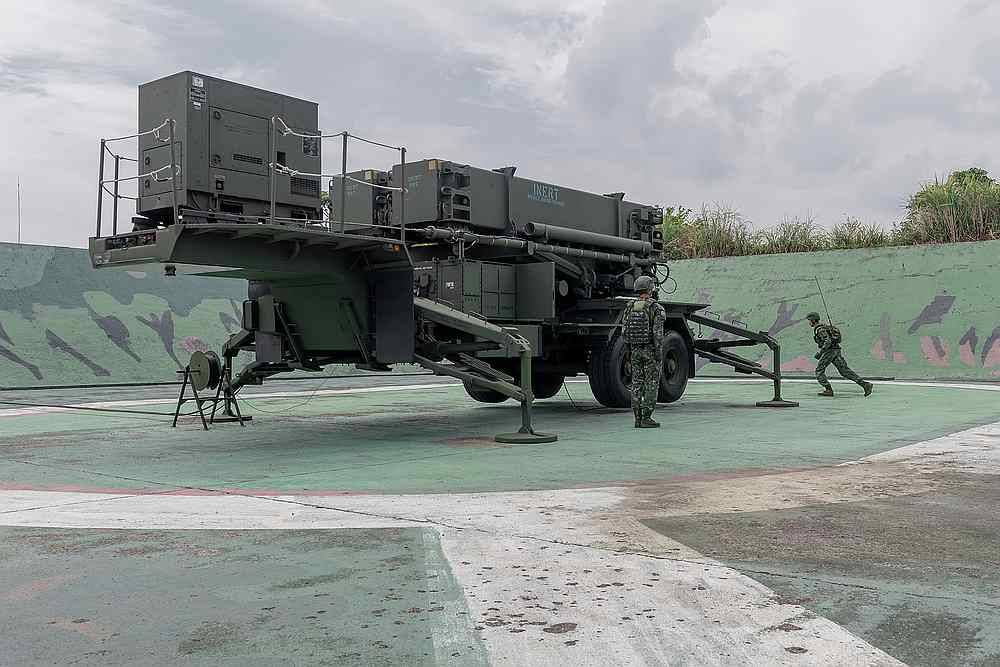 Soldiers are seen near military equipment at a Taiwan air defence missile base at an undisclosed location in this photo released September 11, 2020. — Taiwan Presidential Office handout via Reuters