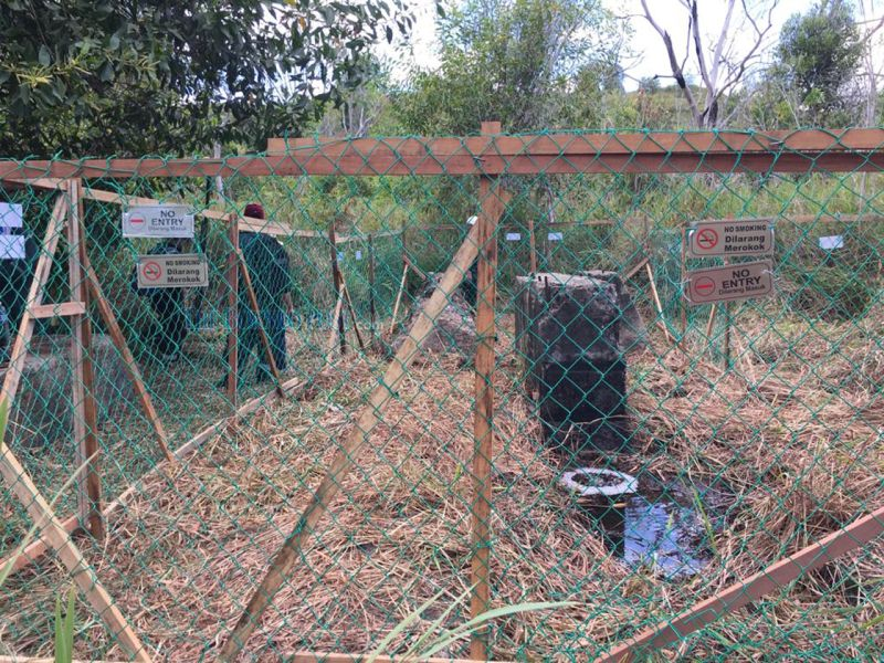 One of the well sites on Canada Hill, fenced off by Shell following the discovery of the LNG leakage. — Borneo Post pic