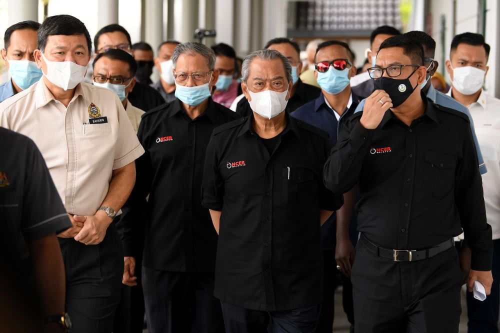 Prime Minister Tan Sri Muhyiddin Yassin (centre) is pictured with Perak Mentri Besar Datuk Seri Ahmad Faizal Azumu during a working visit to the Pangkor Jetty September 15, 2020. — Bernama pic