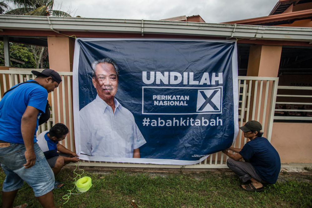 An election poster featuring Perikatan Nasional chairman Tan Sri Muhyiddin Yassin is seen in Kota Belud, Sabah September 16, 2020. — Picture by Firdaus Latif