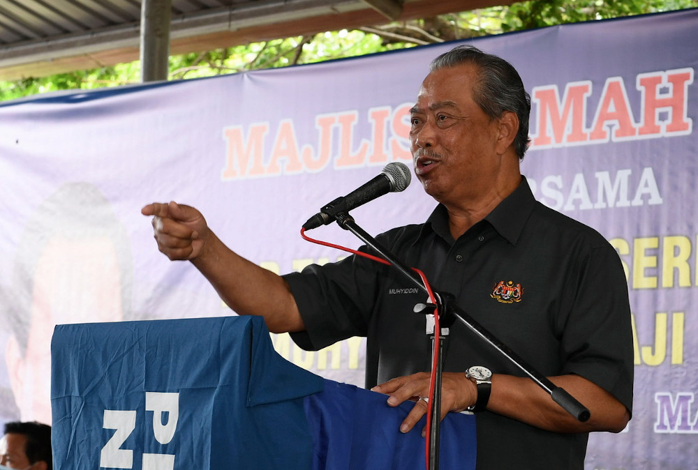 Prime Minister Tan Sri Muhyiddin Yassin delivering a speech during a meet and greet programme with at Tapak Tamu Pekan Kuala Penyu in Sabah, September 17, 2020. — Bernama pic