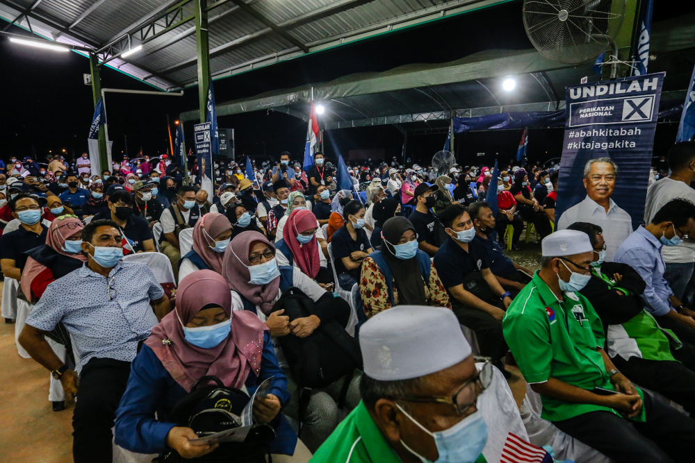 Perikatan Nasional supporters listen to a campaign speech by PN chairman Tan Sri Muhyidin Yassin in Putatan, Sabah September 24, 2020. — Picture by Firdaus Latif