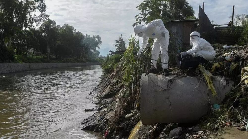 Researchers in Nepal collect samples of sewage dumped into a river to trace the coronavirus spread. — AFP pic