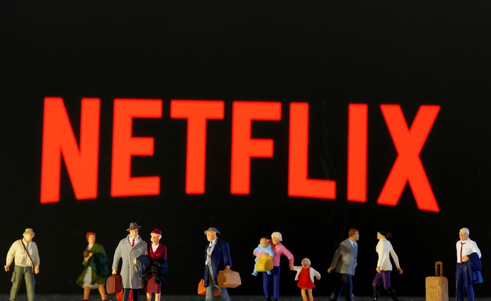 Small toy figures are seen in front of diplayed Netflix logo in this illustration taken March 19, 2020. — Reuters pic