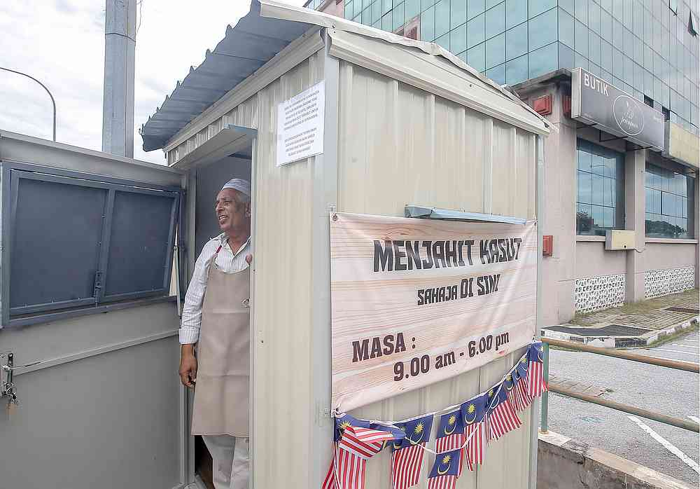 Osman Sidek's repair booth now doubles up as his home. — Picture by Farhan Najib