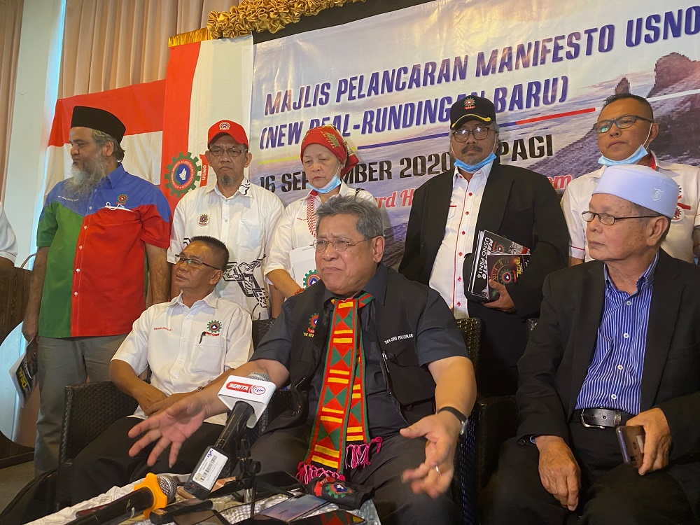 Usno Baru president Tan Sri Pandikar Amin Mulia (centre) speaks during the party's manifesto launch at the Courtyard Hotel in 1Borneo Shopping Centre, Kota Kinabalu September 16, 2020. ― Picture by Julia Chan