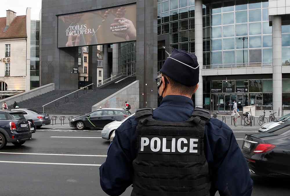 A French police stands near the Opera Bastille where a suspect in a stabbing attack near the former offices of the magazine Charlie Hebdo has been arrested in Paris, France September 25, 2020. — Reuters pic