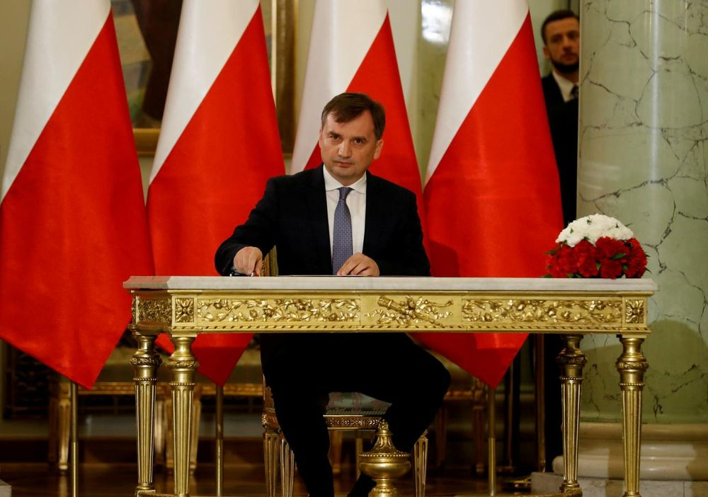 File picture shows Zbigniew Ziobro signing documents after being designated as Minister of Justice, at the Presidential Palace in Warsaw, Poland November 15, 2019. — Reuters pic