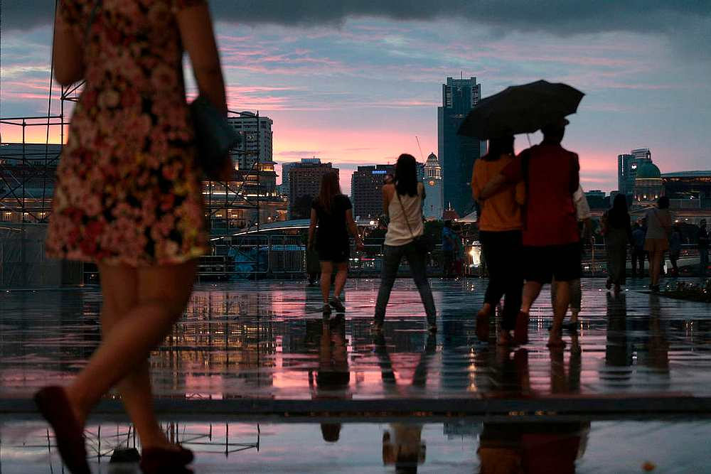 Short-duration moderate to heavy thundery showers can still be expected over parts of Singapore between the late morning and afternoon on most days in the second half of September 2020. — TODAY pic