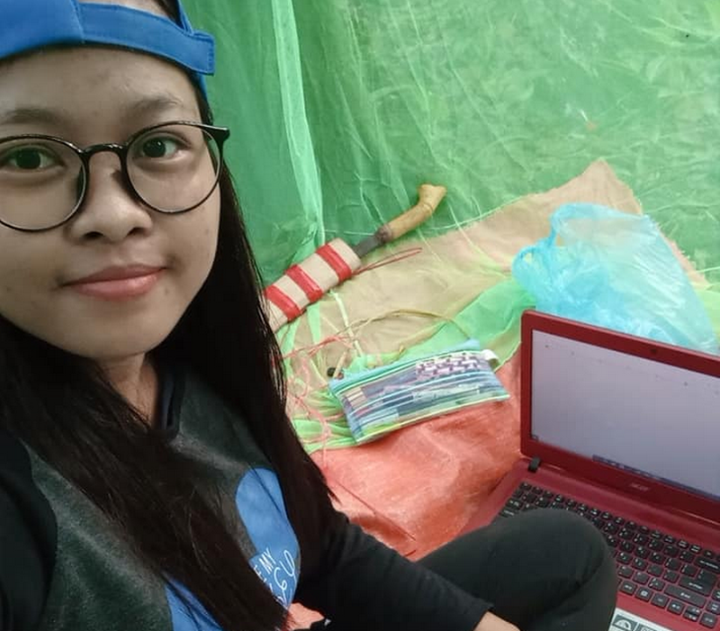 Universiti Pendidikan Sultan Idris student Rose camped in a forested site in her family's rubber estate for better internet connection. — Picture via Facebook