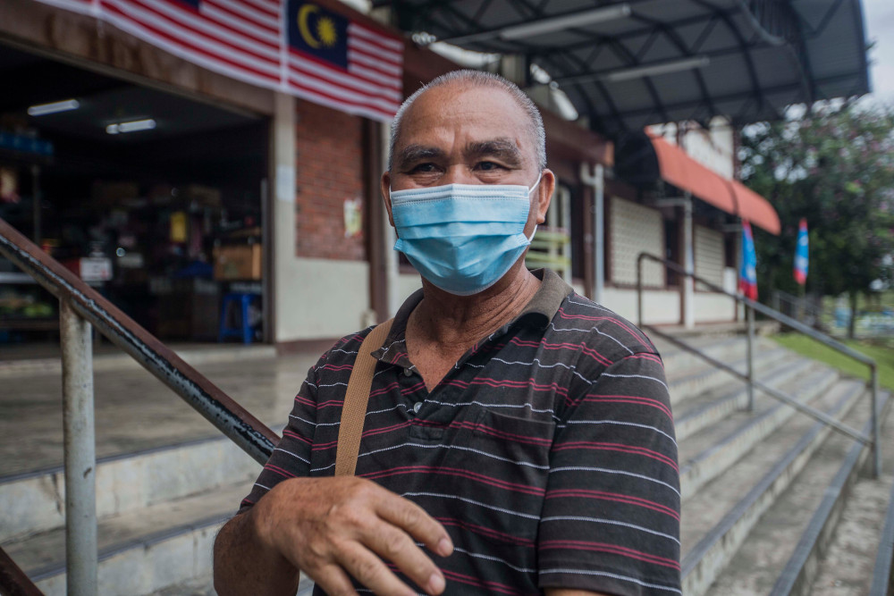 Sambag Gunting, 64, a retired logistics supervisor, said the constant jumping between parties convinced him against supporting Kenny Chua or any of his allies. — Picture by Firdaus Latif