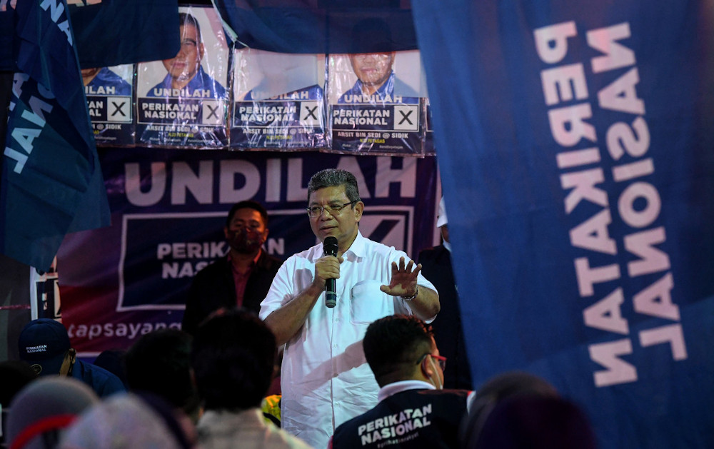 Communications and Multimedia Minister Datuk Saifuddin Abdullah delivering a speech during the Sabah State Election campaign at the Kampung Ulu Putatan Open Hall in Sabah, September 23, 2020. — Bernama