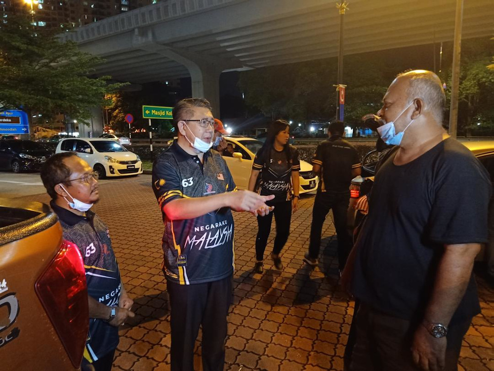 Pulai MP Datuk Seri Salahuddin Ayub (centre) moments before his cycling event in Johor Baru was interrupted by Johor Baru City Council (MBJB) on Merdeka Day eve. — Picture by Amni Jagat