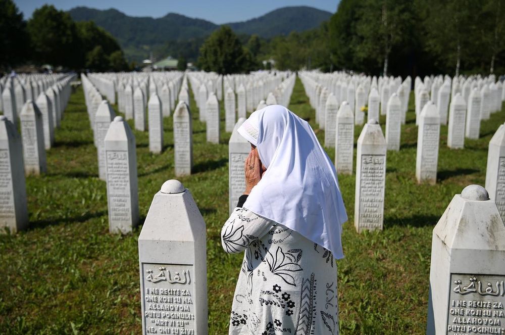 File picture shows a woman praying at a graveyard, ahead of a mass funeral in Potocari near Srebrenica, Bosnia and Herzegovina, July 11, 2020. — Reuters pic