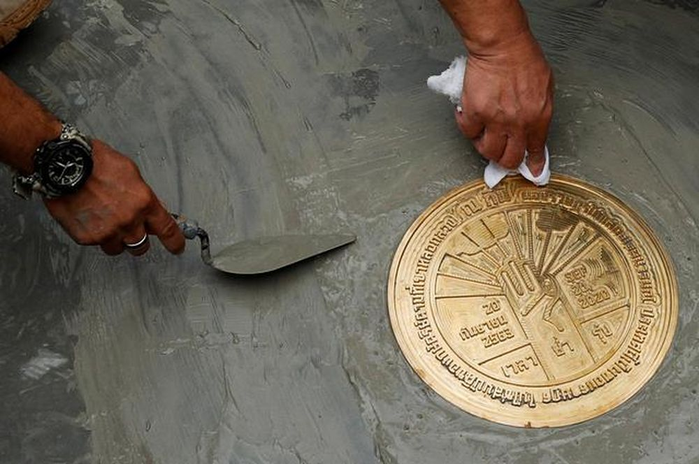 Student leaders install a plaque declaring 'This country belongs to the people' during a mass rally to call for the ouster of Prime Minister Prayuth Chan-ocha and reforms in the monarchy, near the Grand Palace in Bangkok, Thailand, September 20, 2020.