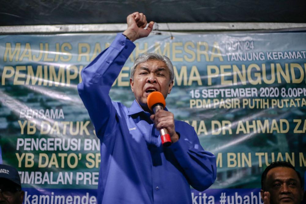 File photo of Datuk Seri Ahmad Zahid Hamidi speaking while campaigning for Shahelmey Yahaya, BN Tanjung Keramat candidate in Tanjung Keramat, Sabah September 15, 2020. — Picture by Firdaus Latif