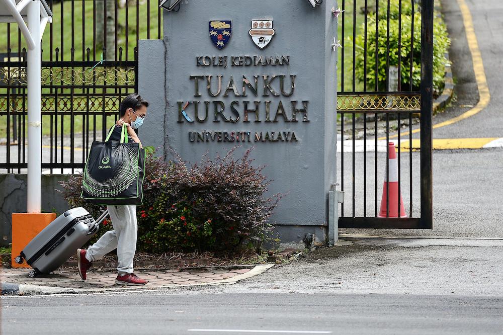 A new student arrives for registration at Tunku Kurshiah residential college in Universiti Malaya, October 3, 2020. — Bernama pic