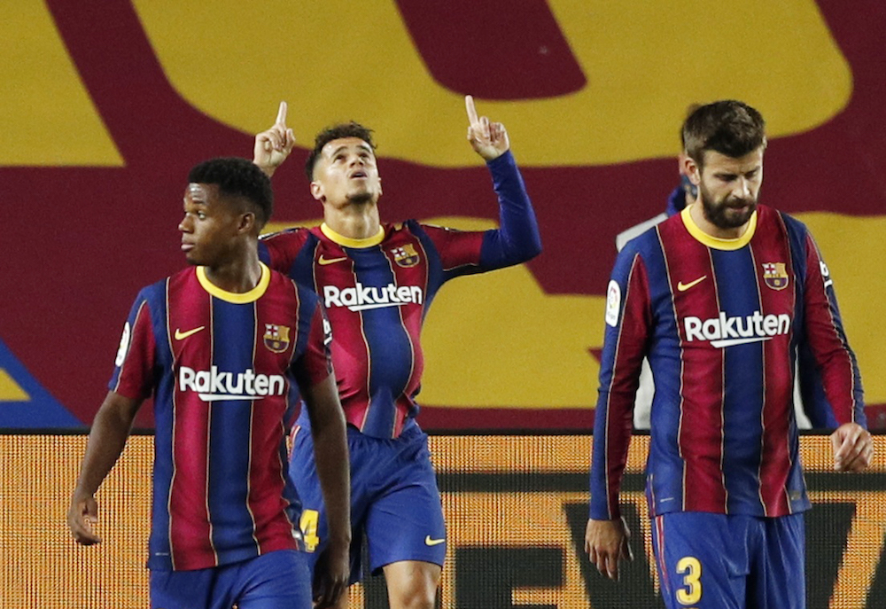 Barcelona's Philippe Coutinho celebrates scoring their first goal with teammates, October 5, 2020. — Reuters pic