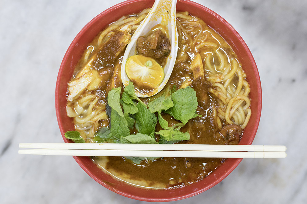A big bowl of 'curry mee', with extra cockles.