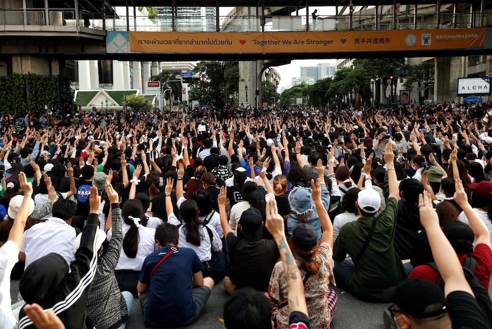 Pro-democracy protesters show the three-finger salute as they gather demanding the government to resign and to release detained leaders in Bangkok, Thailand October 15, 2020. — Reuters pic