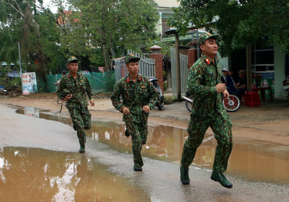 Military personnel, part of the rescue team, are deployed to search for missing people at a site of a landslide near a hydropower dam in Thua Thien Hue province, Vietnam October 14, 2020. — Tran Le Lam/VNA handout via Reuters