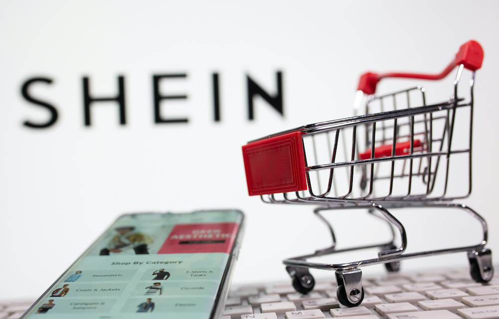 A keyboard and a shopping cart are seen in front of a displayed Shein logo in this illustration picture taken October 13, 2020. — Reuters/Dado Ruvic illustration