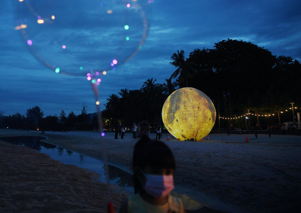 The inflatable giant 'moon' on Batu Hitam beach in Kuantan October 18, 2020. — Bernama pic
